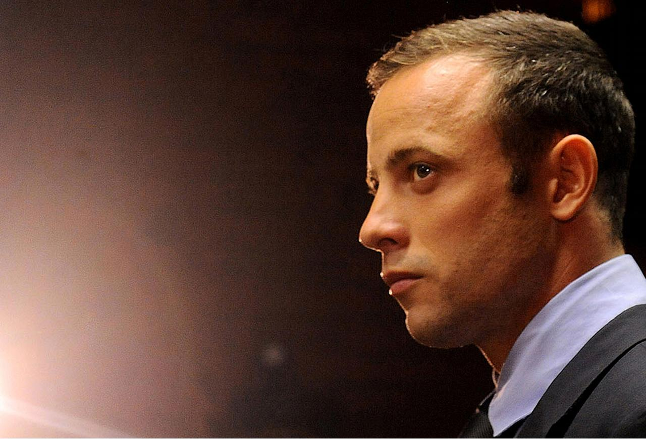 FILE - In this photo taken Friday, Feb. 22, 2013 Olympic athlete, Oscar Pistorius, in court in Pretoria, South Africa, for his bail hearing charged with the shooting death of his girlfriend, Reeva Steenkamp. Even if Pistorius is acquitted of murder, firearms and legal experts in South Africa believe that, by his own account, the star violated basic gun-handling regulations by shooting into a closed door without knowing who was behind it, exposing himself to the lesser but still serious charge of culpable homicide. (AP Photo/Themba Hadebe, File)