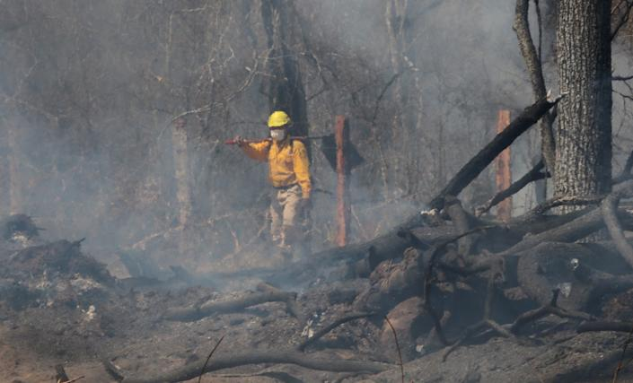 Bolivian soldiers at a forest wildfire near Robore, Santa Cruz region, Bolivia, on Aug. 22. (Photo: Stringer/AFPTV/AFP/Getty Images)