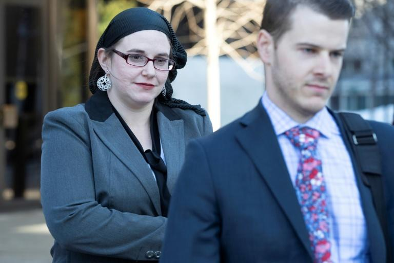 Caitlin Coleman leaves the Ottawa court house in March 2019 after testifying against her husband (AFP Photo/Lars Hagberg)