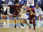 Boston College's Clara Ford, left, and Clara Ford (10) battle for a loose ball with Pittsburgh's Sandrine Clesca (0) in the opening round of the Atlantic Coast Conference Tournament, Wednesday, March 3, 2021, at the Greensboro Coliseum in Greensboro, N.C. (Walt Unks/The Winston-Salem Journal via AP)