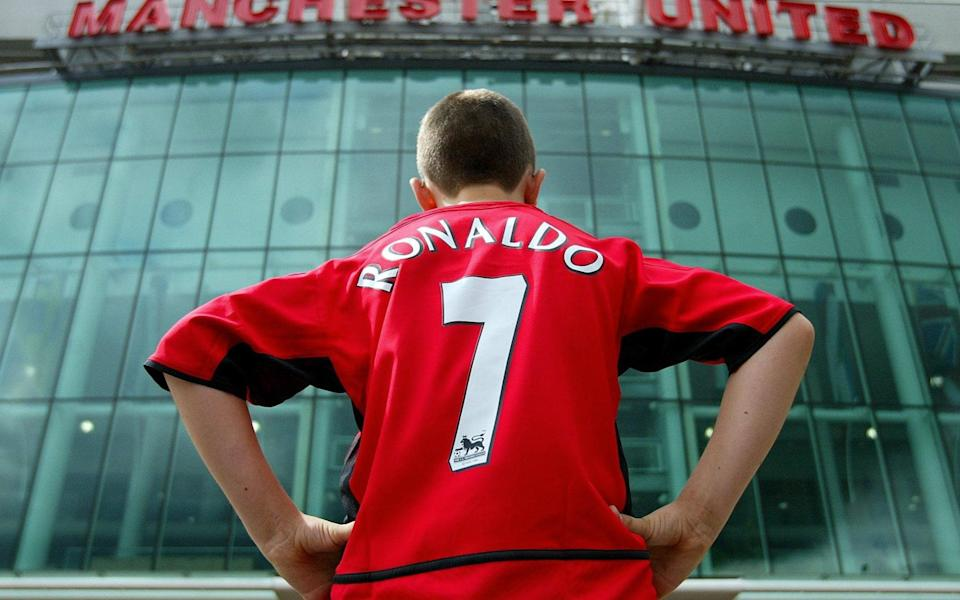 Manchester United fan Steven Markey wears a replica kit bearing the name of the club's new signing Cristiano Ronaldo outside Old Trafford, Manchester, Wednesday August 13, 2003 - PA