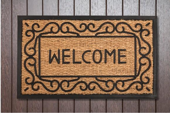 A welcome mat lying on a deck.