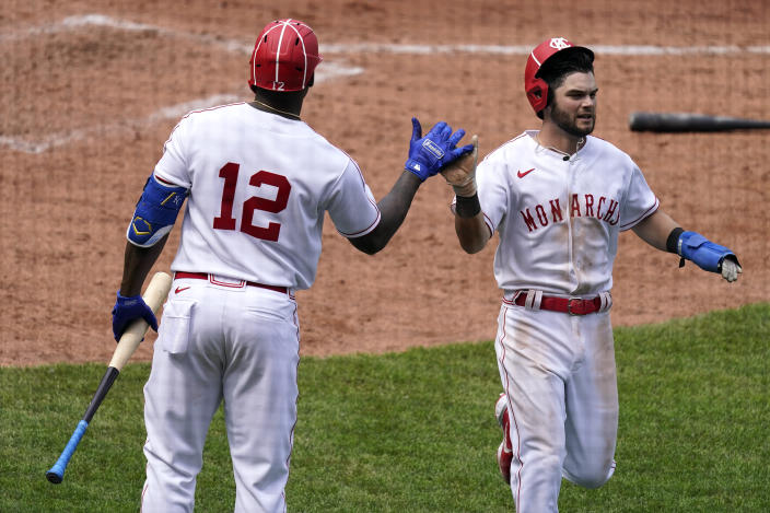 Kansas City Royals' Andrew Benintendi celebrates with Jorge Soler (12) after scoring on a sacrifice fly hit by Hanser Alberto during the seventh inning of a baseball game against the Detroit Tigers Sunday, May 23, 2021, in Kansas City, Mo. (AP Photo/Charlie Riedel)