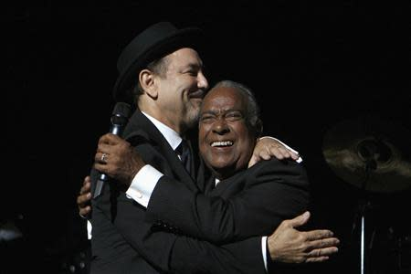 "File picture shows Puerto Rican salsa singer Jose ""Cheo"" Feliciano embracing Panamanian singer Ruben Blades in San Juan"