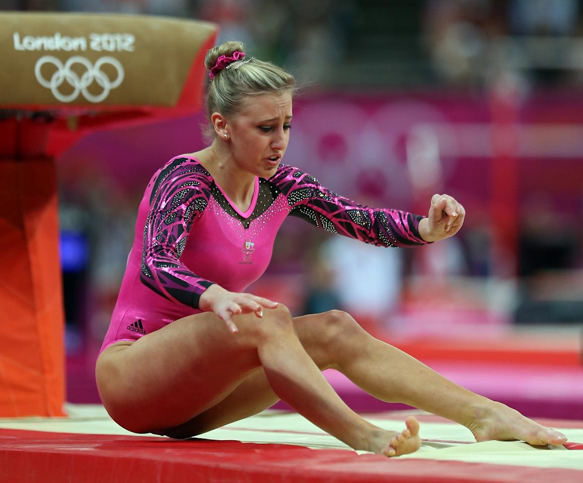 Ashleigh Brennan of Australia falls on her landing on the vault in the Artistic Gymnastics Women's Individual All-Around final on Day 6 of the London 2012 Olympic Games at North Greenwich Arena on August 2, 2012 in London, England.  (Photo by Julian Finney/Getty Images)