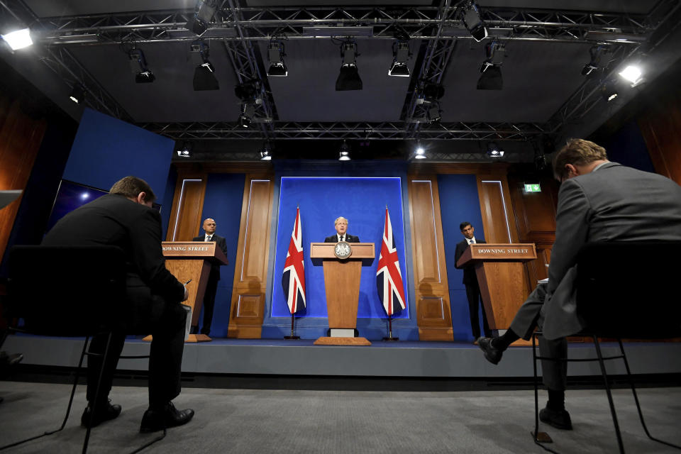 """From left, Britain's Health Secretary Sajid Javid, Prime Minister Boris Johnson and Chancellor of the Exchequer Rishi Sunak attend a media briefing in Downing Street, London, Tuesday, Sept. 7, 2021. Johnson has announced a tax increase to pay for the rocketing cost of the long-term care needed by Britain's growing older population. Johnson told lawmakers in the House of Commons that he had made the """"difficult but responsible"""" decision to hike taxes in order to raise 36 billion pounds ($50 billion) over three years for social care and the overstretched National Health Service. (Toby Melville/Pool Photo via AP)"""