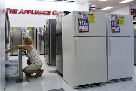 A woman shops for refrigerators at a store in New York in this file photo taken July 28, 2010. REUTERS/Shannon Stapleton/Files