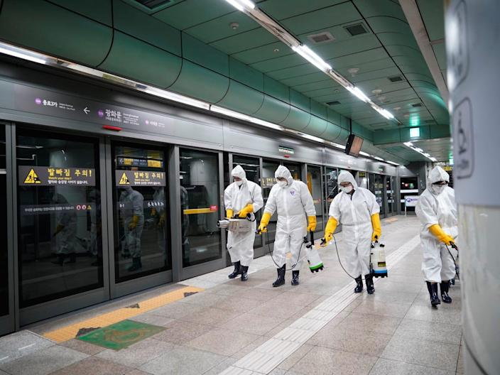Employees from a disinfection service company sanitize a subway station in Seoul, South Korea, February 28, 2020. REUTERS/Kim Hong-Ji