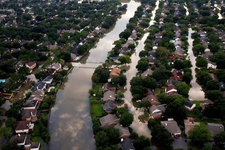 FILE PHOTO: Houses are seen partially submerged in flood waters caused by Tropical Storm Harvey in Northwest Houston, Texas, U.S., August 30, 2017.REUTERS/Adrees Latif/File Photo