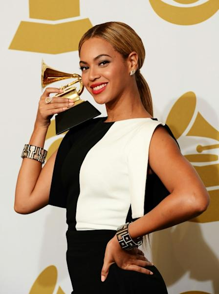 Singer Beyonce, seen here with one of her many Grammy awards, is one of the inspirational women included in the book (AFP Photo/Jason Merritt)