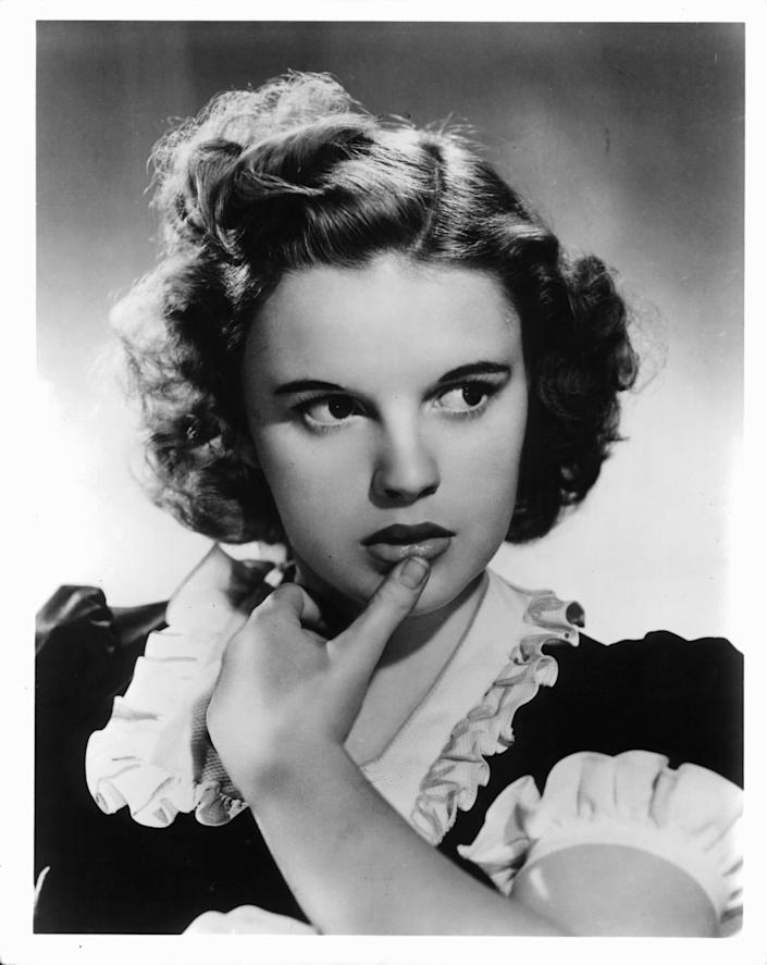 "<p>Actress and singer Judy Garland was a star almost from birth. Though she's often remembered for her iconic renditions of songs such as ""Over the Rainbow,"" she also was an extraordinary performer whom audiences adored. Born in 1922 as Frances Gumm, Judy was the daughter of former vaudevillians Frank and Ethel Gumm, who ran a theater in Grand Rapids, Michigan. She made her stage debut at age 2 ½, singing ""Jingle Bells"" and performing alongside her two older sisters. </p><p>At age 13, Judy was signed by Hollywood's largest movie studio, Metro-Goldwyn Mayer (MGM). Her golden voice, youthful innocence and spirited personality made her an international sensation almost immediately. Despite the pressures of fame and an unsettled personal life, Judy made comeback after comeback through the years and endeared herself to fans in her feature films, stage appearances, and concerts around the world. A new biopic,<em><a href=""https://www.youtube.com/watch?v=oMVvThpqBmU"" rel=""nofollow noopener"" target=""_blank"" data-ylk=""slk:Judy"" class=""link rapid-noclick-resp""> Judy</a></em>, with Renee Zellweger in the title role, is being released this fall. </p><p>Here's a look at her many decades in the spotlight (and if you're interested in learning about other celebs through the years, check out our coverage of <a href=""https://www.goodhousekeeping.com/beauty/g3608/lucille-ball-vintage-photos/"" rel=""nofollow noopener"" target=""_blank"" data-ylk=""slk:Lucille Ball"" class=""link rapid-noclick-resp"">Lucille Ball</a> and <a href=""https://www.goodhousekeeping.com/life/entertainment/g3641/audrey-hepburn-vintage-photos/"" rel=""nofollow noopener"" target=""_blank"" data-ylk=""slk:Audrey Hepburn"" class=""link rapid-noclick-resp"">Audrey Hepburn</a>. </p>"