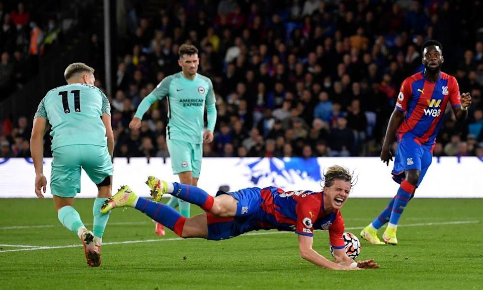 Leandro Trossard (left) is judged to have fouled Crystal Palace's Conor Gallagher at the end of the first half.