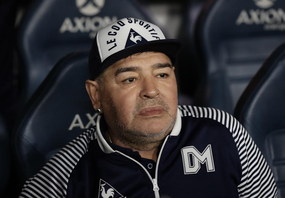 Argentine former football star Diego Maradona gestures during an homage before the start of the Argentina First Division 2020 Superliga Tournament football match Boca Juniors vs Gimnasia La Plata, at La Bombonera stadium, in Buenos Aires, on March 7, 2020. (Photo by ALEJANDRO PAGNI / AFP) (Photo by ALEJANDRO PAGNI/AFP via Getty Images)