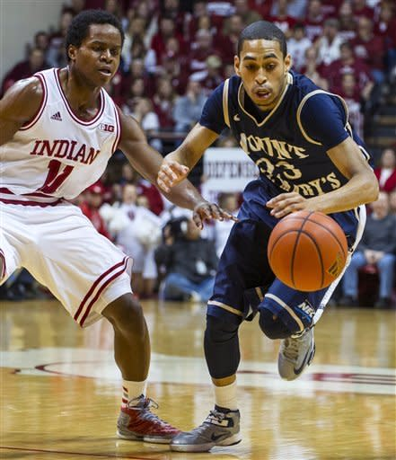 Mount St. Mary's Julian Norfleet rushes to regain control of the ball after Indiana's Kevin Ferrell knocked it loose during the first half of an NCAA college basketball game, Wednesday, Dec. 19, 2012, in Bloomington, Ind. (AP Photo/Doug McSchooler)