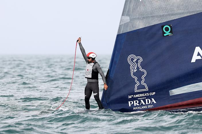 AUCKLAND, NEW ZEALAND - JANUARY 17: An American Magic crew member stands on the bow after the boats capsizes in race two against Prada Luna Rossaduring the 2021 PRADA Cup Round Robins on Auckland Harbour on January 17, 2021 in Auckland, New Zealand. (Photo by Fiona Goodall/Getty Images)