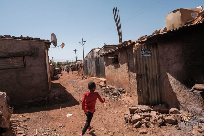 An Eritrean refugee child runs in an alley at Mai Aini Refugee camp, in Ethiopia, on January 30, 2021. / Credit: EDUARDO SOTERAS/AFP via Getty Images