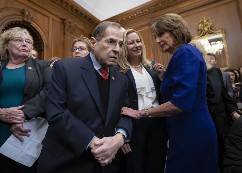 In this file photo from Friday, Jan. 4, 2019, Speaker of the House Nancy Pelosi, D-Calif., right, has a quick word with Rep. Jerrold Nadler, D-N.Y., center, chairman of the House Judiciary Committee, at the Capitol in Washington. Nadler says that he believes President Donald Trump obstructed justice and that House Democrats are requesting documents from scores of people from Trump's administration, family and business as part of the Russia probe. Nadler says the House Judiciary Committee on Monday is requesting documents from the Justice Department, Donald Trump Jr. and Trump Organization executive Alan Weisselberg. (AP Photo/J. Scott Applewhite, file)