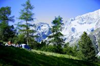 """<p><span>The mountain views and the fresh alpine air are the main appeal at </span><a href=""""https://coolcamping.com/campsites/europe/switzerland/1852-camping-arolla"""" rel=""""nofollow noopener"""" target=""""_blank"""" data-ylk=""""slk:Camping Arolla"""" class=""""link rapid-noclick-resp""""><span>Camping Arolla</span></a><span>, which sits 2,000 meters up in the Swiss Alps. Popular with the more adventurous, camping spots here are a mixture of pine-tree hideouts and open areas with views across to the north face of Mont Collon. A tent and two people from 26CHF (£20). [Photo: Cool Camping]</span> </p>"""