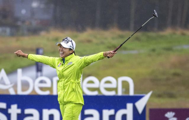 South Korea's Mi Jung Hur celebrates holing her birdie putt to win the Ladies Scottish Open at The Renaissance Club in North Berwick, Scotland, Sunday Aug. 11, 2019. (Kenny Smith/PA via AP)