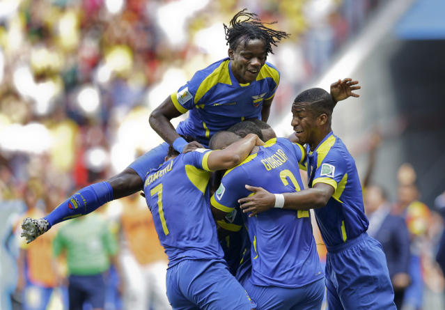 Ecaudor players celebrate after Enner Valencia scored the opening goal during the group E World Cup soccer match between Switzerland and Ecuador at the Estadio Nacional in Brasilia, Brazil, Sunday, June 15, 2014. (AP Photo/Michael Sohn)