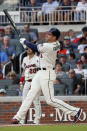 Atlanta Braves' Freddie Freeman follows through on a two-run homer in the sixth inning of a baseball game against the Chicago White Sox Sunday, Sept. 1, 2019, in Atlanta. It was Freeman's second two-run home run of the game. (AP Photo/John Bazemore)