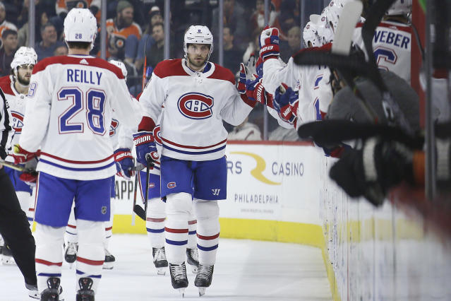 Montreal Canadiens' Ben Chiarot celebrates with teammates after scoring a goal during the second period of an NHL hockey game against the Philadelphia Flyers, Thursday, Nov. 7, 2019, in Philadelphia. (AP Photo/Matt Slocum)