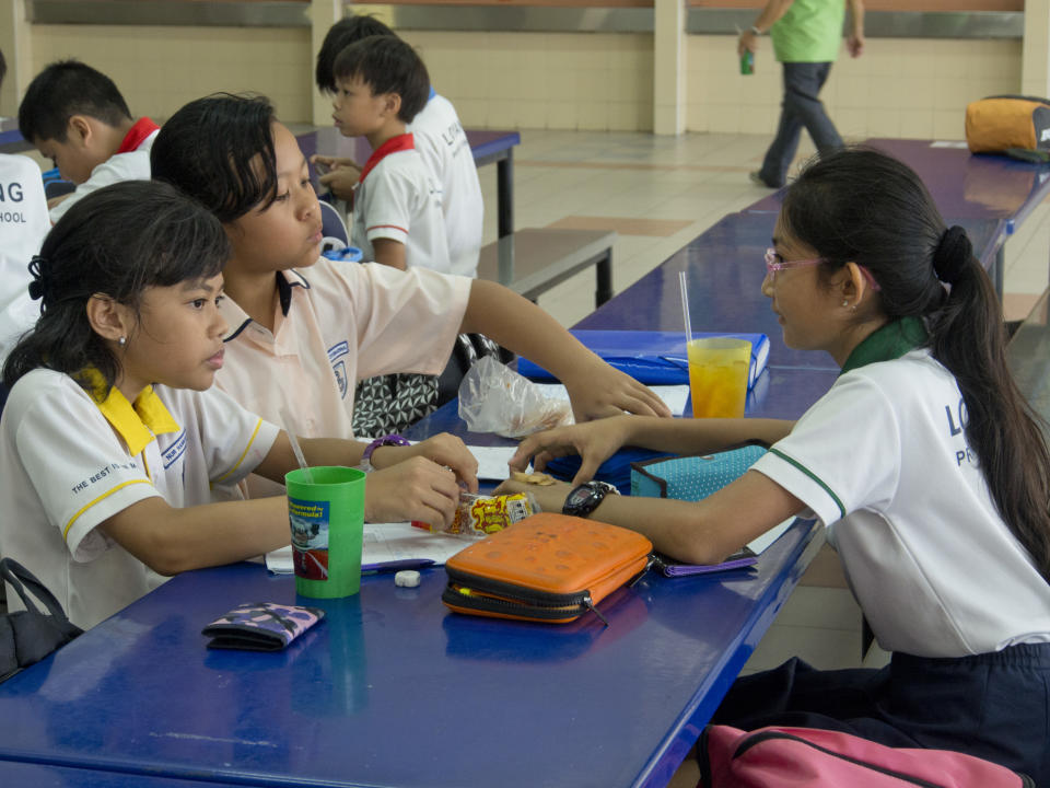 School children in primary school in Singapore. (Photo by: Majority World/Universal Images Group via Getty Images)