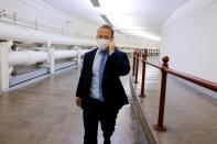 U.S. Representative Gottheimer traverses an underground walkway amidst ongoing negotiations over budget and infrastructure legislation at the U.S. Capitol in Washington