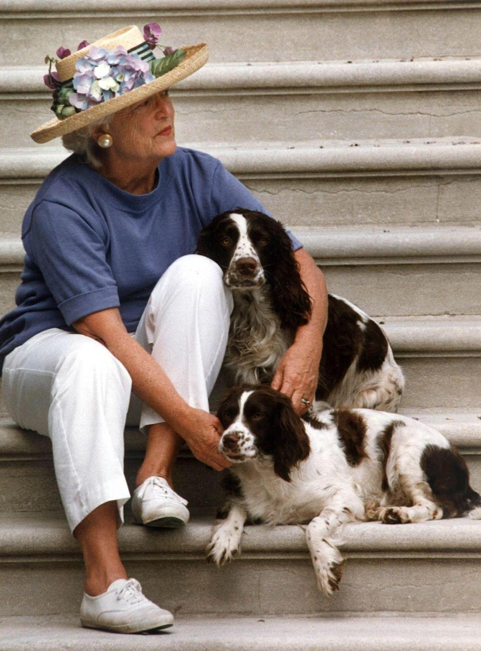"<p>Even off-duty, Barbara Bush was never seen without her iconic red lipstick or a shade a blue. She <a href=""http://www.firstladies.org/blog/what-first-ladies-wore-barbara-bush-hillary-clinton-part-4/"" rel=""nofollow noopener"" target=""_blank"" data-ylk=""slk:always strived"" class=""link rapid-noclick-resp"">always strived</a> to wear red, white, and blue during her time as a former first lady. This outfit definitely checks all of those boxes.</p>"