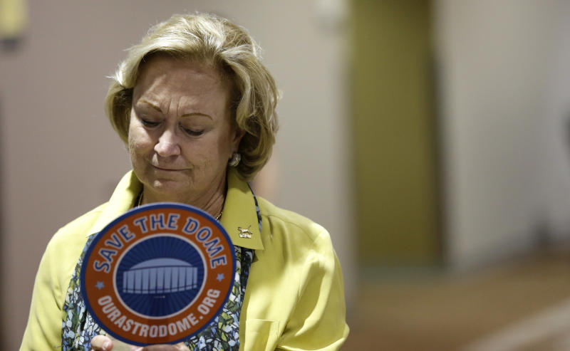 """Sally Allen looks down as she joins other supporters during a """"Save the Dome"""" election results party Tuesday, Nov. 5, 2013, in Houston. Houston-area voters are deciding whether to convert the Astrodome into a convention center or allow the iconic stadium to be demolished.(AP Photo/David J. Phillip)"""