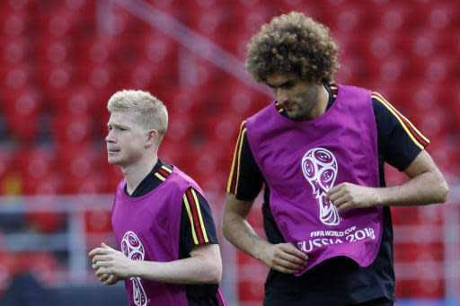 Belgium's Kevin De Bruyne, left, and Belgium's Marouane Fellaini warm up during Belgium's official training ahead of the group G match between Belgium and Tunisia at the 2018 soccer World Cup in the Spartak Stadium in Moscow, Russia, Friday, June 22, 2018. (AP Photo/Hassan Ammar)
