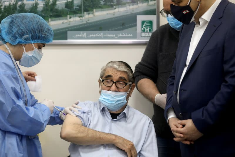 Salah Tizani, 92, known as Abou Salim and one of Lebanon's first TV celebrities, receives a dose of the Pfizer/BioNTech vaccine against the coronavirus disease (COVID-19)