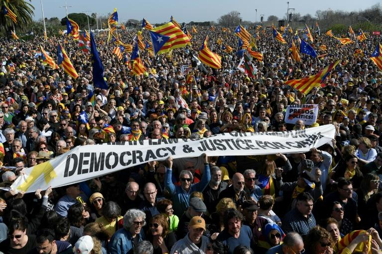 Catalan flags were prominent among the throng gathered to hear Puigdemont (AFP Photo/LLUIS GENE)