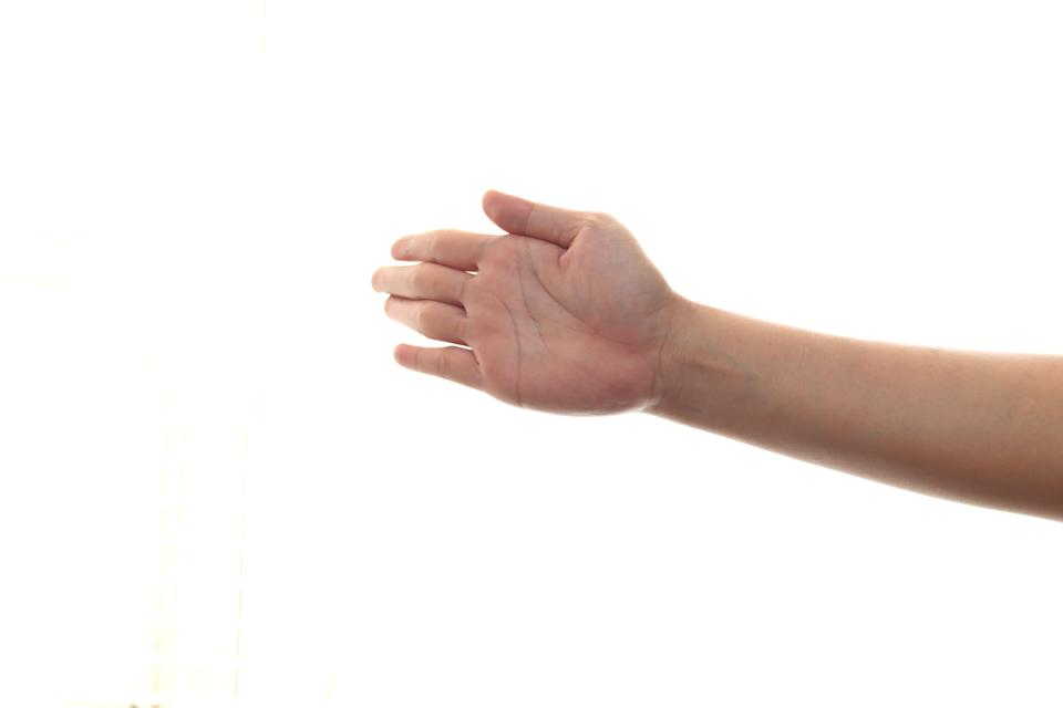 Hand of a person slapping gesture, isolated on white background