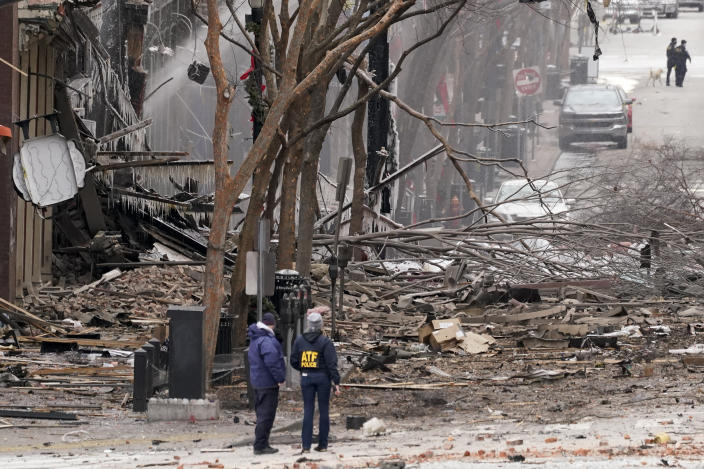 Emergency personnel work near the scene of an explosion in downtown Nashville, Tenn., on Dec. 25, 2020. (Mark Humphrey/AP)