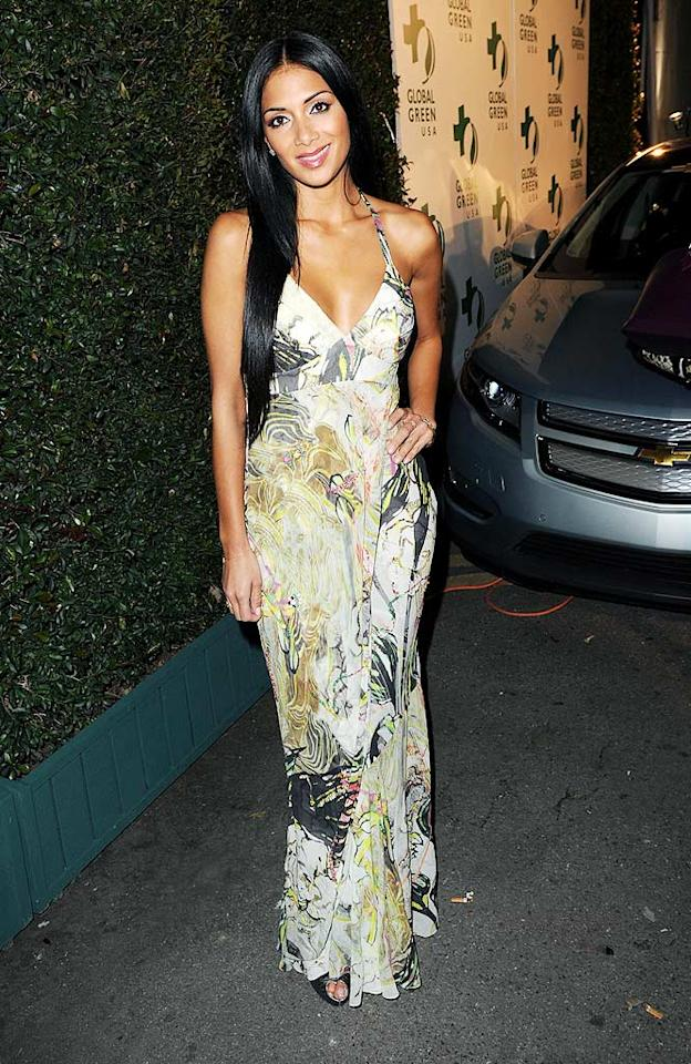 """Pussycat Doll Nicole Scherzinger looked lovely in a long, printed halter dress. The singer's had a great 2010 so far, landing a prime spot in the star-studded remake of """"We Are the World"""" and a slot on the upcoming season of """"Dancing With the Stars."""" Jason Merritt/<a href=""""http://www.gettyimages.com/"""" target=""""new"""">GettyImages.com</a> - March 3, 2010"""