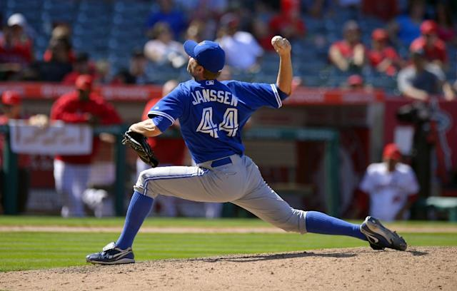 Toronto Blue Jays relief pitcher Casey Janssen throws to the plate during the ninth inning of their baseball game against the Los Angeles Angels, Sunday, Aug. 4, 2013, in Anaheim, Calif. (AP Photo/Mark J. Terrill)