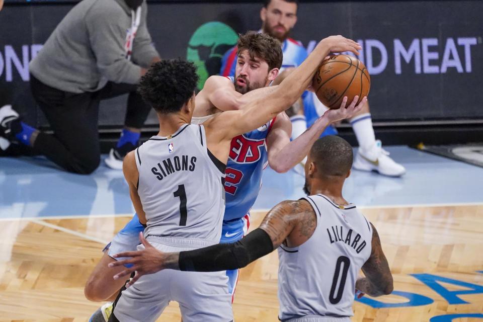 Portland Trail Blazers guards Anfernee Simons (1) and Damian Lillard (0) guard against Brooklyn Nets forward Joe Harris (12) during the first half of an NBA basketball game, Friday, April 30, 2021, in New York. (AP Photo/Mary Altaffer)