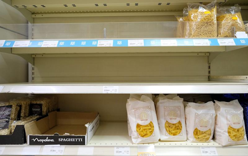 Almost-empty shelves where pasta would normally be stocked are pictured inside a supermarket store in north London on March 31, 2020, as life in Britain continues during the nationwide lockdown to combat the novel coronavirus pandemic. - The novel coronavirus pandemic has so far claimed nearly 38,000 lives worldwide in a health crisis that is rapidly reorganising political power, hammering the global economy and the daily existence of some 3.6 billion people. (Photo by Isabel INFANTES / AFP) (Photo by ISABEL INFANTES/AFP via Getty Images)