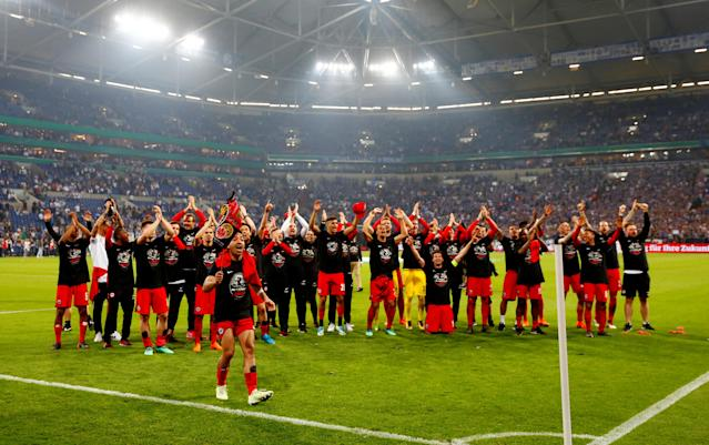 Soccer Football - DFB Cup - Schalke 04 vs Eintracht Frankfurt - Veltins-Arena, Gelsenkirchen, Germany - April 18, 2018 Eintracht Frankfurt players celebrate in front of their fans after reaching the final REUTERS/Wolfgang Rattay DFB RULES PROHIBIT USE IN MMS SERVICES VIA HANDHELD DEVICES UNTIL TWO HOURS AFTER A MATCH AND ANY USAGE ON INTERNET OR ONLINE MEDIA SIMULATING VIDEO FOOTAGE DURING THE MATCH.