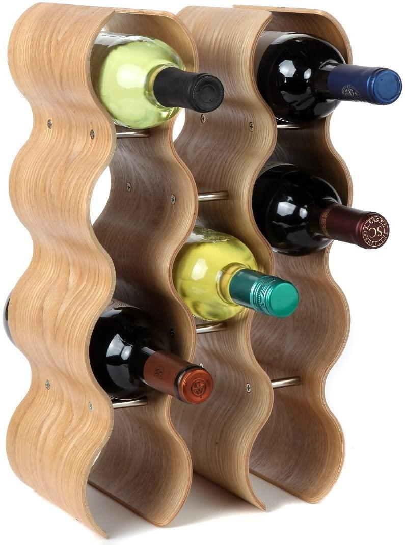 """<h3>Countertop Wave Wine Rack</h3><br>In case you haven't heard, <a href=""""https://www.refinery29.com/en-us/2021/02/10327315/wavy-2021-home-decor-trends"""" rel=""""nofollow noopener"""" target=""""_blank"""" data-ylk=""""slk:wavy home buys are in"""" class=""""link rapid-noclick-resp"""">wavy home buys are in</a> — and this countertop wine rack, crafted from smooth oak wood, is undulating with groovy energy. <br><br><strong>Lily's Home</strong> Countertop Wave Wine Rack, $, available at <a href=""""https://amzn.to/3dPzQ0n"""" rel=""""nofollow noopener"""" target=""""_blank"""" data-ylk=""""slk:Amazon"""" class=""""link rapid-noclick-resp"""">Amazon</a>"""