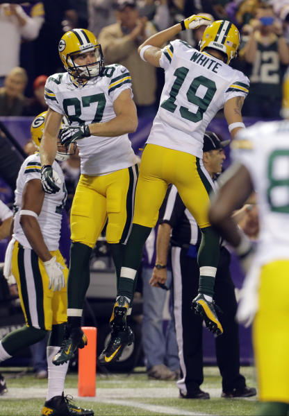 Green Bay Packers wide receiver Jordy Nelson, left, celebrates his touchdown with wide receiver Myles White (19) in the first half of an NFL football game Sunday, Oct. 27, 2013, in Minneapolis. (AP Photo/Ann Heisenfelt)