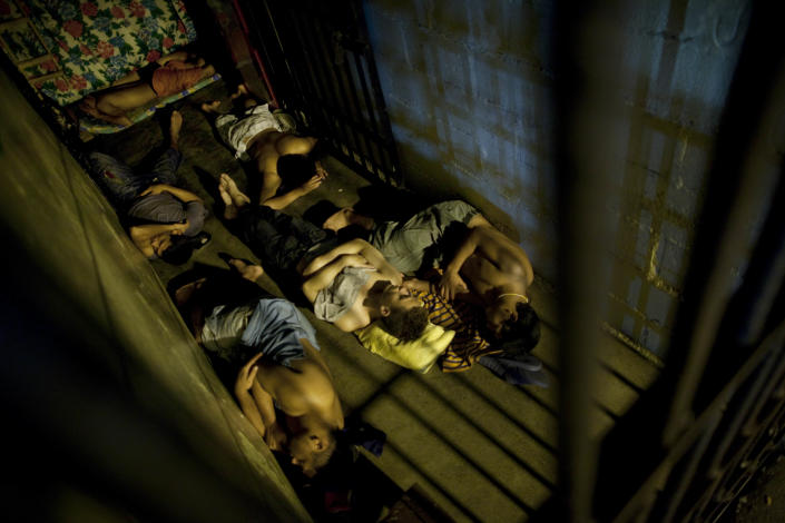 In this May 3, 2012 photo, inmates sleep inside their cell in San Pedro Sula Central Corrections Facility in San Pedro Sula, Honduras. Inside one of Honduras' most dangerous and overcrowded prisons, inmates operate a free-market bazaar, selling everything from iPhones to prostitutes. Guards do not cross into the inner sanctum controlled by prisoners, and prisoners do not breach the perimeter controlled by guards. (AP Photo/Rodrigo Abd)