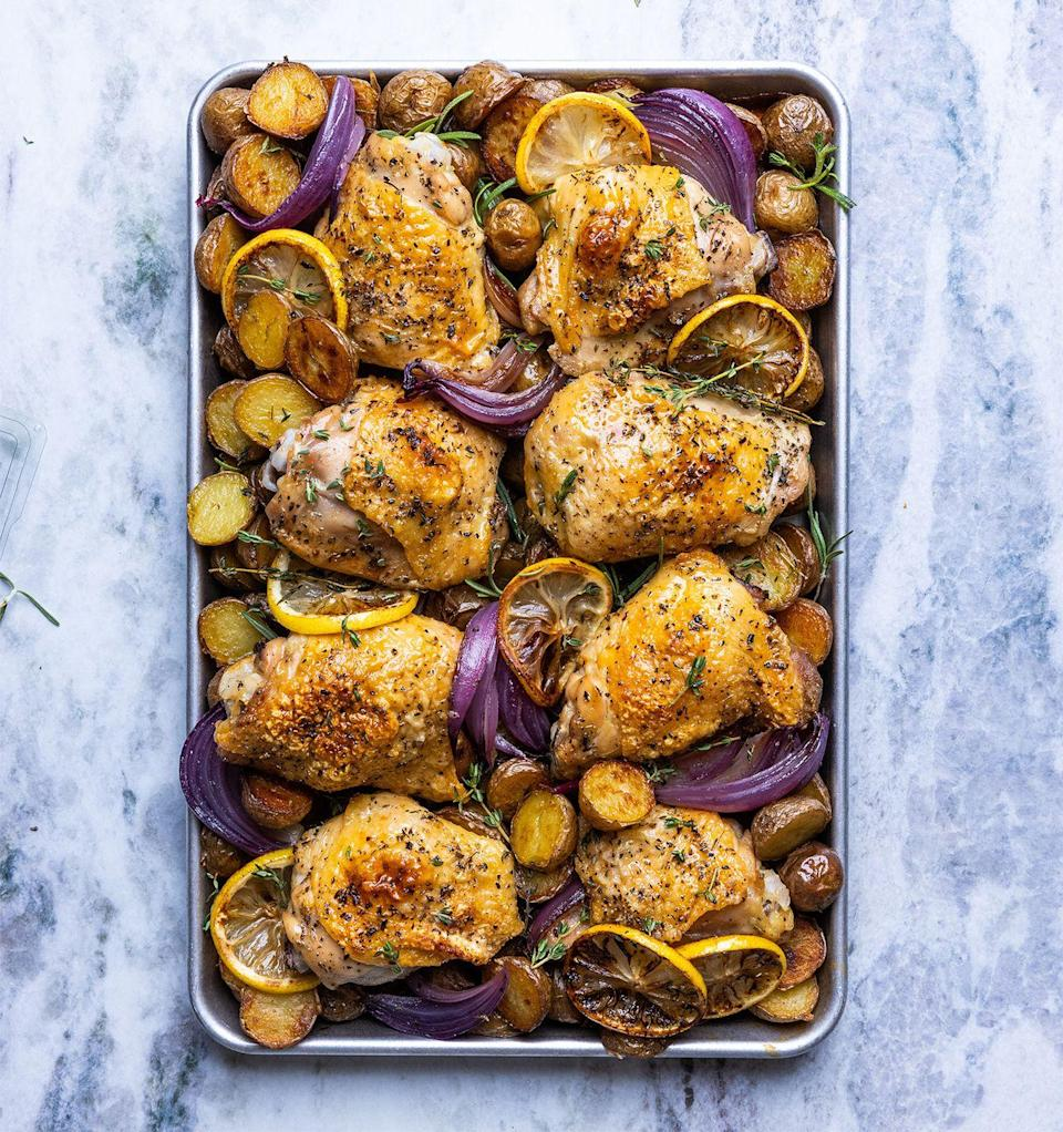 """<p>Lemon zest, thyme, and oregano, and baked chicken give these potatoes tons of flavor.</p><p>Get the recipe from <a href=""""https://www.delish.com/cooking/recipe-ideas/a37418736/sheet-pan-chicken-thighs-recipe/"""" rel=""""nofollow noopener"""" target=""""_blank"""" data-ylk=""""slk:Delish"""" class=""""link rapid-noclick-resp"""">Delish</a>.</p>"""