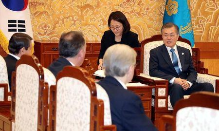 South Korean President Moon Jae-in talks with delegation of the Olympic Athletes from Russia during their meeting at the Presidential Blue House in Seoul, South Korea, February 20, 2018. Yonhap/via REUTERS