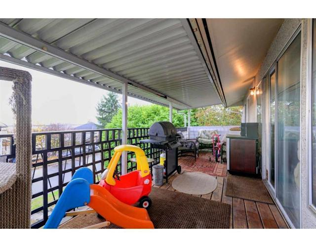 <p><span>324 Blue Mountain St., Coquitlam, B.C.</span><br> The covered balcony is a great place to relax outside.<br> (Photo: Zoocasa) </p>