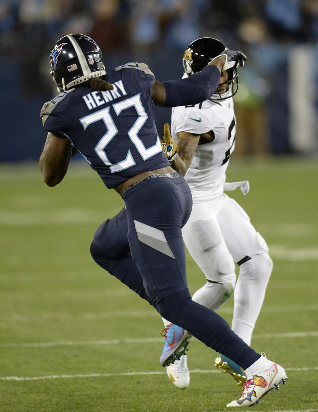 Tennessee Titans running back Derrick Henry (22) runs against Jacksonville Jaguars cornerback A.J. Bouye (21) during the first half of an NFL football game, Thursday, Dec. 6, 2018, in Nashville, Tenn. Henry scored a touchdown on the 99-yard run. (AP Photo/Mark Zaleski)