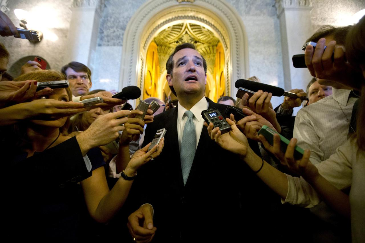 "U.S. Senator Ted Cruz (R-TX) speaks to the press after leaving the Senate Chamber after a marathon attack on ""Obamacare,"" at the U.S. Capitol in Washington, September 25, 2013. Standing in a nearly empty Senate Chamber, Cruz spent more than 21 hours making his case to deny funding to implement President Barack Obama's landmark overhaul of the U.S. healthcare system, arguing it is hurting the economy. REUTERS/Jason Reed (UNITED STATES - Tags: POLITICS TPX IMAGES OF THE DAY)"