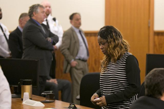 Olivia Thibou, sister of the victim, walks back to her seat after former NFL player Aaron Hernandez was convicted in his murder trial at the Bristol County Superior Court in Fall River, Massachusetts, April 15, 2015. Hernandez, 25, a former tight end for the New England Patriots, is convicted of fatally shooting semiprofessional football player Odin Lloyd in an industrial park near Hernandez's Massachusetts home in June 2013. REUTERS/Dominick Reuter