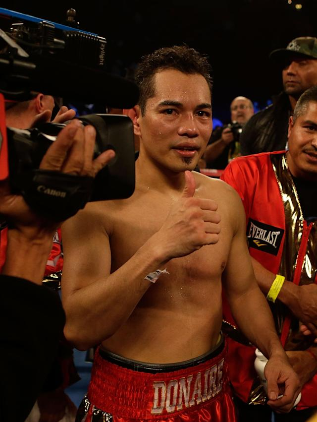 HOUSTON, TX - DECEMBER 15: Nonito Donaire of the Philippines celebrates after his victory over Jorge Arce of Mexico in the third round of their WBO World Super Bantamweight bout at the Toyota Center on December 15, 2012 in Houston, Texas. (Photo by Scott Halleran/Getty Images)